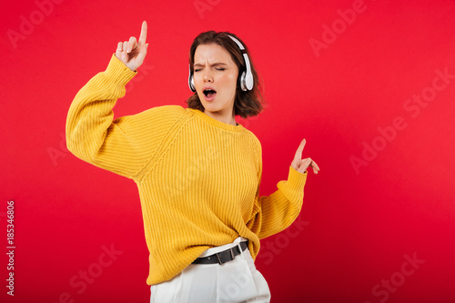 Portrait of a cheerful woman in headphones