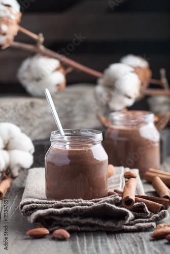 Foto op Aluminium Milkshake Homemade chocolate pudding with cocoa, carob, cinnamond and almond milk in jar