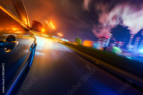 Car on the road with motion blur background. - 185366472