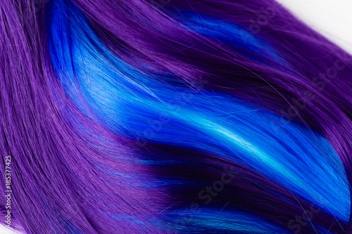 Closeup of colorful hair in purple and turquoise blue colors - 185377425