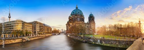Leinwanddruck Bild Beautiful panoramic view of Berlin Dome during sunset against  blue sky