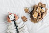 Top view of woman hands holding hot chocolate in bed  - 185380646