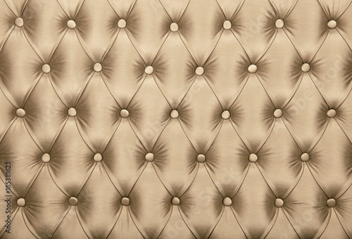 Beige capitone tufted fabric upholstery texture