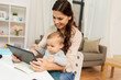 mother student with baby and tablet pc at home