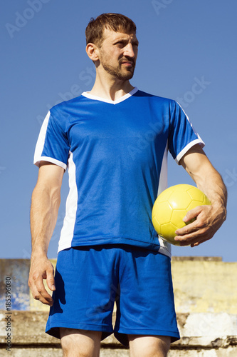 Fotobehang Voetbal standing soccer player