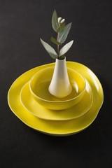Flower vase kept on porcelain crockery