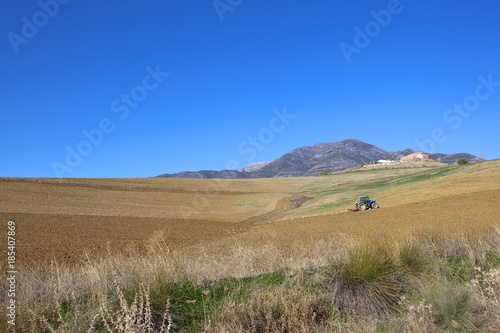 Foto op Canvas Natuur plowing soil