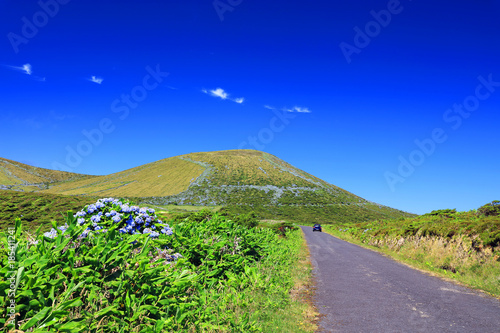 Foto op Plexiglas Donkerblauw Mountain road on Flores Island, Azores, Portugal, Europe