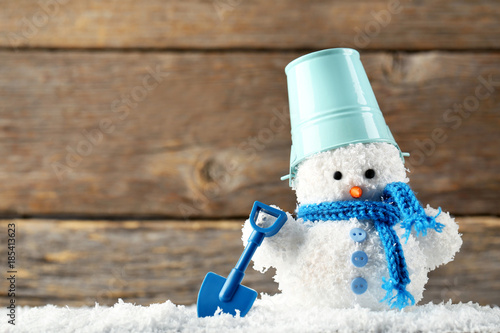 Poster Small snowman toy with shovel and bucket