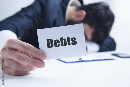 Foto Murales man holding paper with debt word