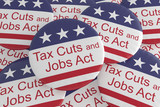 USA Politics News Badges: Pile of Tax Cuts And Jobs Act Buttons With US Flag, 3d illustration - 185427664