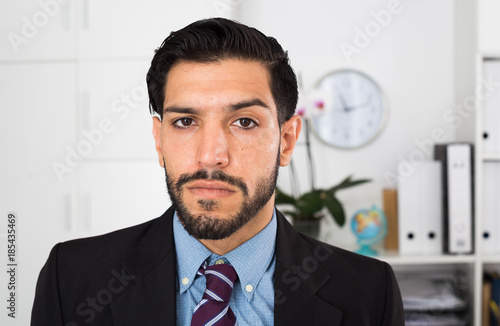 Serious businessman is at his work place