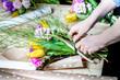 The florist assemble a bouquet