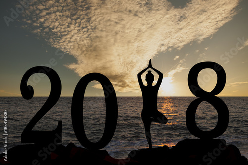 New year 2018 yoga concept woman pose