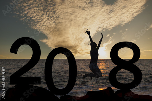 Woman jumping New Year 2018