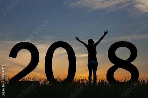Silhouette young woman happy for 2018 new year