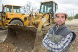 Portrait of construction worker next to digger - 185506402