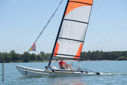 Fotobehang Zeilen Man on sailing vessel