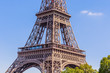 Fragment of the Eiffel tower on a bright sunny day. Paris, France
