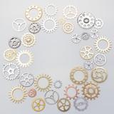 metallic gears background. Closeup of metal cog gears. Decorative frame
