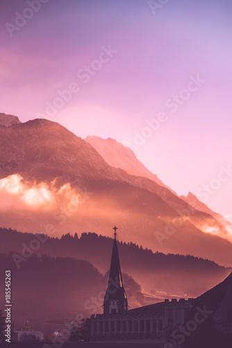 Fotobehang Lichtroze Innsbruck Sunrise with Church Cross