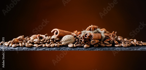 Roasted coffee beans with spices . - 185563293