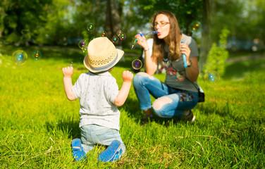 Mom, son and bubbles