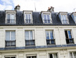 Paris, France. Typical Houses in Paris with special attention to their roofs and windows