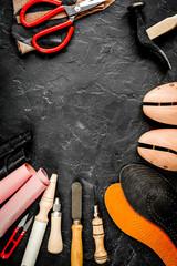 cobbler tools in workshop dark background top view mock up