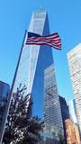 New York One World Trade Center Skyscraper and USA waving flag - 185582236