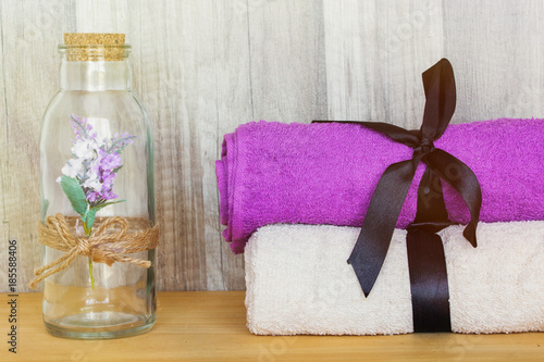 Foto op Plexiglas Lavendel Towels with decorative bottle. Beauty Spa Health and Wellness concept.