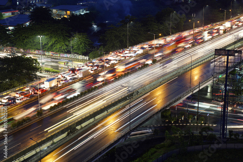 Papiers peints Autoroute nuit Cityscape of Jakarta city at night with the glitter of lights vehicles, buildings, and houses residents.