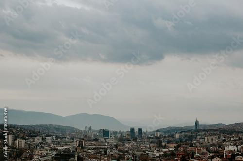 Dramatic cloudy city view of Sarajevo, Bosnia and Herzegovina. Cloudy rainy day in the capital city Sarajevo. - 185617496