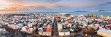 Aerial panorama of downtown Reykjavik at sunset with colorful houses and commercial streets - 185631231