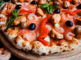 Mediterranean pizza with seafood and olives. Classical italian recipe concept - 185639628