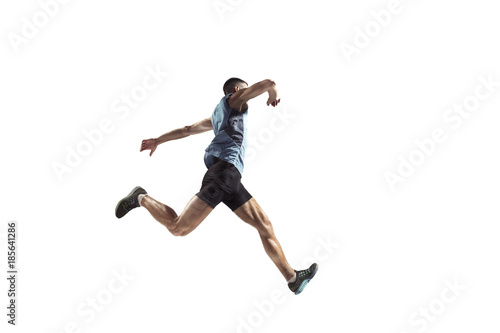 The studio shot of high jump athlete is in action