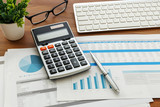 Financial accounting with calculator and fianancial data - 185643490