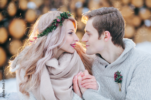 Foto Murales Couple in love warms each other's hands. Winter wedding. Close-up portrait of Beautiful newlyweds.