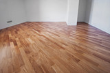 Flooring from a parquet oak board in an interior with bright light from a window. - 185688672