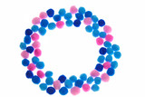 Pompon background. round frame of pink, light blue and blue small pompons isolated on white background. Needlework, hobby, creativity with children concept - 185709228