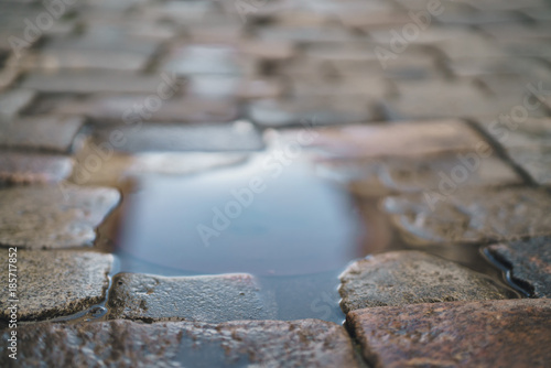 In de dag Stenen puddle on old stone pavement background