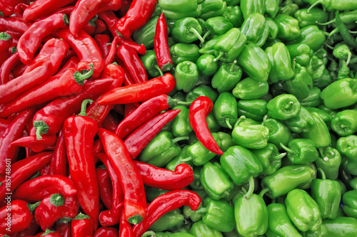 Fresh green and red organic bell peppers capsicum on display for sale at local farmer's market departmental store. - 185748601