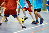 Children playing soccer indoors - 185749441