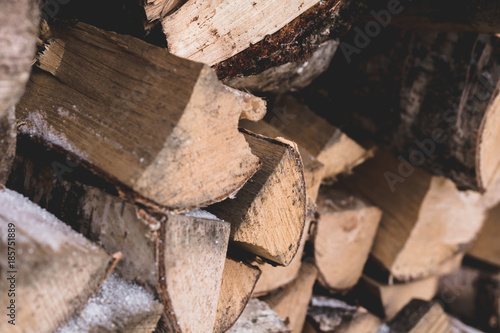 Foto op Aluminium Brandhout textuur Firewood for kindling the fireplace are lying outdoor in the winter