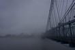cincinnati, ohio and covington kentucky riverfront and bridges in the fog on misty day at dusk