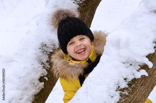 little girl playing in the snow in the winter.
