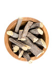 Pile of licorice roots isolated on a white background - 185821637