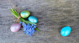 Bouquet Scilla Difolia and colored eggs on the background of an old tree. Spring Easter composition with blue snowdrops - 185836022