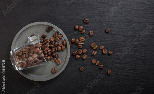 Espresso cup and coffee beans on black background, Top view with copy space