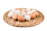 Farm fresh and commerical eggs on a woven mat - 185846810